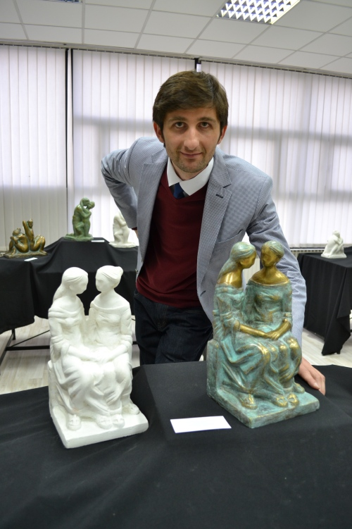 "The artist poses with the sculpture ""Macedonia and Serbia"" in bronze and plaster"